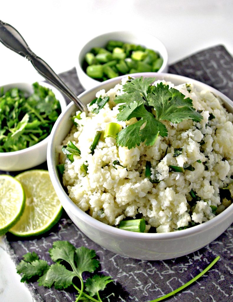 Cilantro Lime Cauliflower Rice with herbs and onions is a delicious grain-free alternative to restaurant-style rice! | spiritedndthensome.com