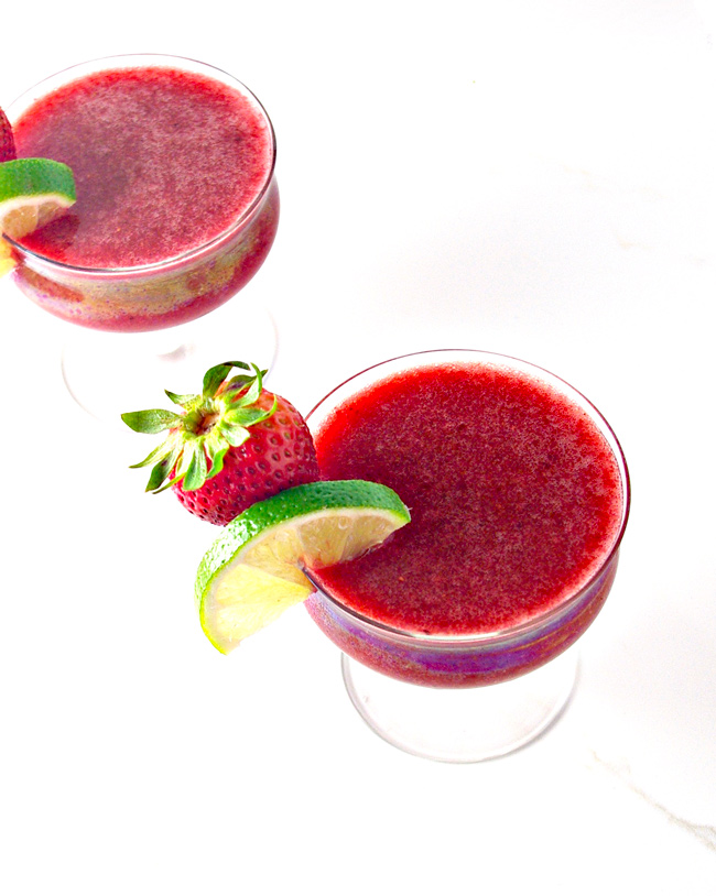 Strawberry Lime Daiquiri uses cherries for an out-of-this-world flavor and color! | spiritedandthensome.com