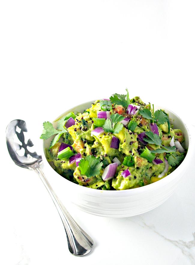 Veggie Guacamole with Fresh Garlic is full of paleo and vegan crunch! | spiritedandthensome.com