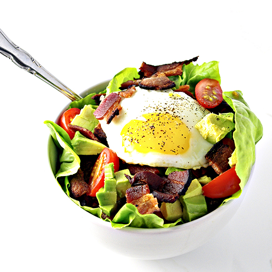 We top Bacon, Lettuce, and Tomato Salad with eggs and avocado! | spiritedandthensome.com