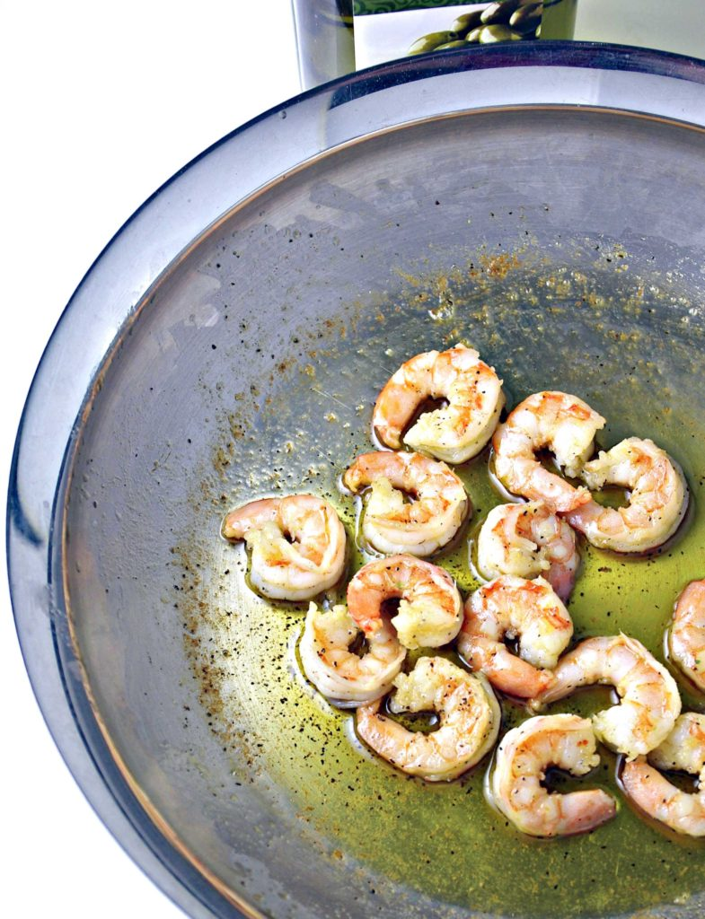 Sautéed shrimp in stainless steel skillet