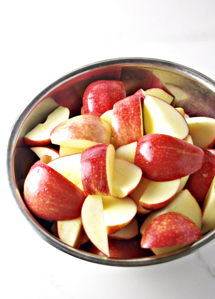 Sliced Gala apples ready to be turned into Homemade Apple Cider | spiritedandthensome.com