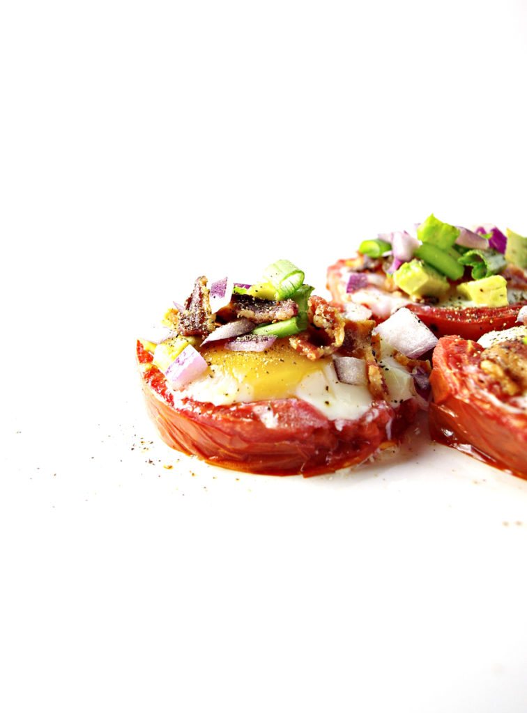 Baked Tomato Cup with Bacon and Eggs is further topped with onion and avocado! | spiritedandthensome.com