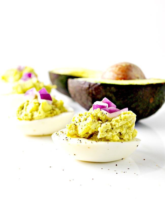 Spicy Avocado Deviled Eggs are a gluten-free, mayo-free, and paleo appetizer! | spiritedandthensome.com