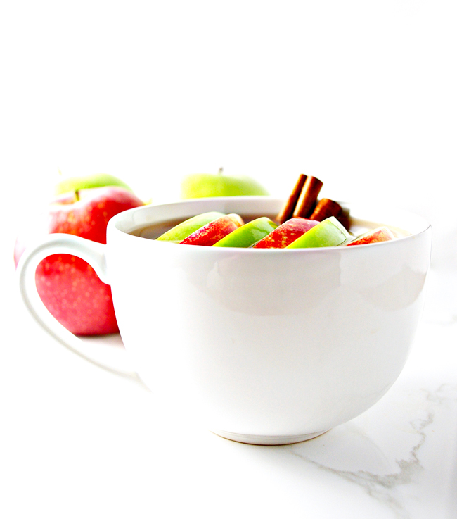 Spiked Sour Apple Cider with fresh cinnamon sticks and sweet and sour apples! | spiritedandthensome.com