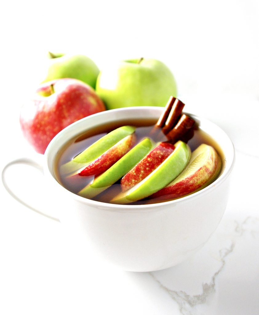 Spiked Sour Apple Cider with Cinnamon Sticks is for the adults at holiday parties! | spiritedandthensome.com