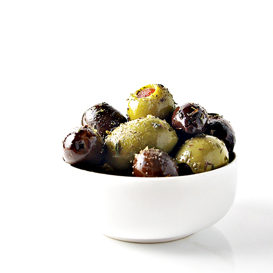 Marinated Greek Olives in a dish | via spiritedandthensome.com