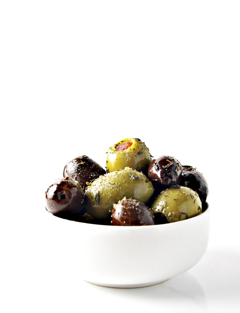 Olives in a white dish - vegan + paleo | via spiritedandthensome.com
