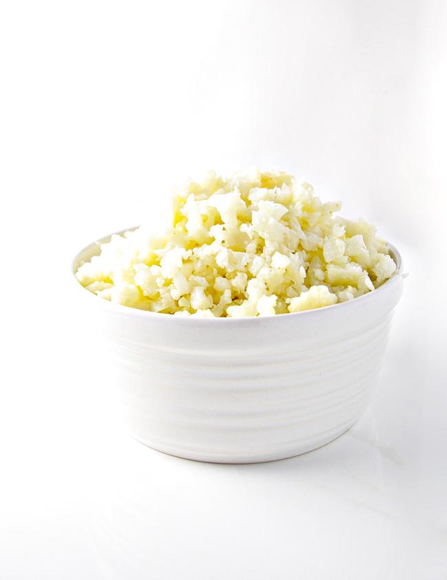 Cauliflower Rice is a grain-free, paleo alternative to traditional rice and tastes AMAZING! | spiritedandthensome.com