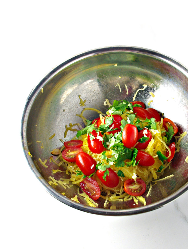 Herbs, tomatoes, and garlic make Paleo Spaghetti Squash Noodles come alive! | spiritedandthensome.com