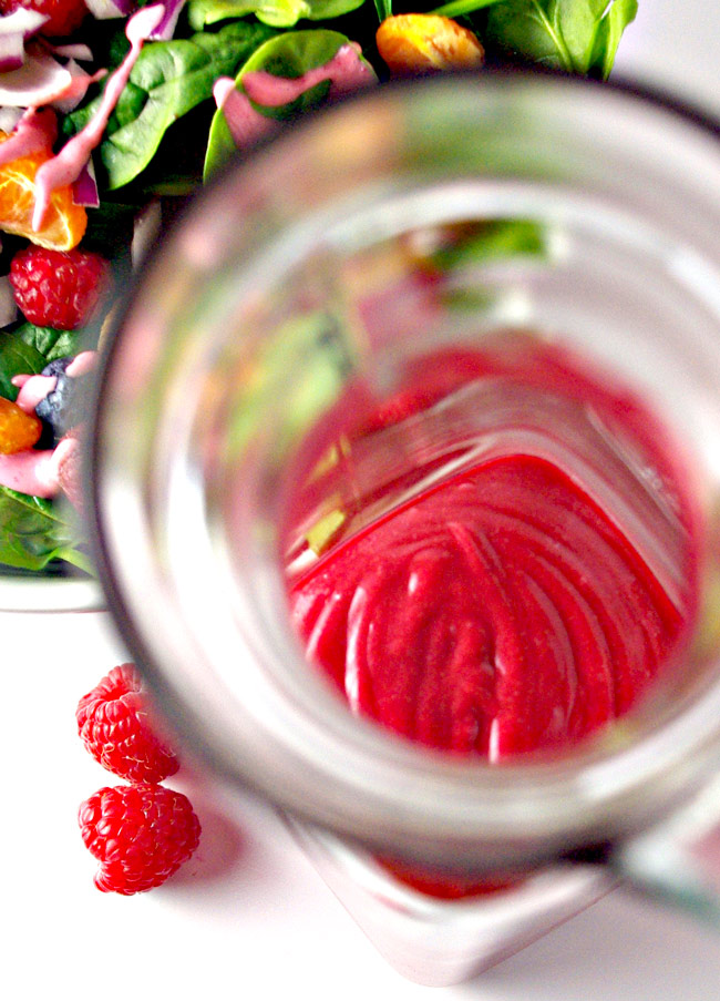 Frozen raspberries give Raspberry Vinaigrette Dressing a beautiful deep hue! | spiritedandthnesome.com