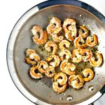 Shrimp are sautéed to perfection in a peppered garlic drizzle! | spiritedandthensome.com