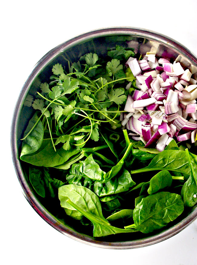 The savory flavors in Berry Spinach Salad include red onions, green onions, and cilantro! | spiritedandthensome.com