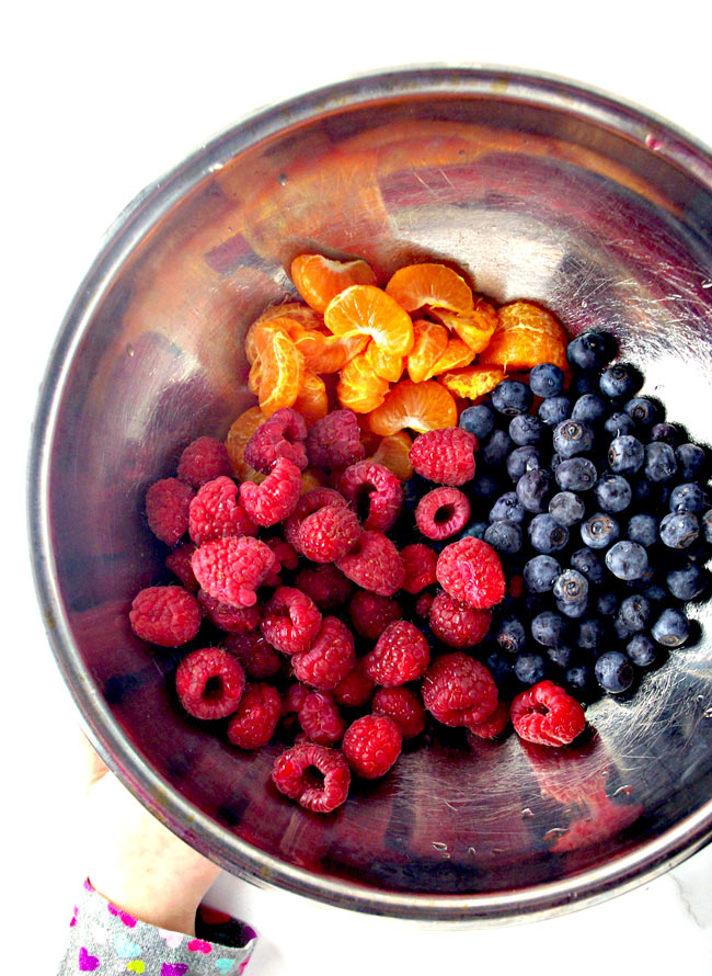 The sweets in Berry Spinach Salad include raspberries, blueberries, and mandarin oranges!   spiritedandthensome.com