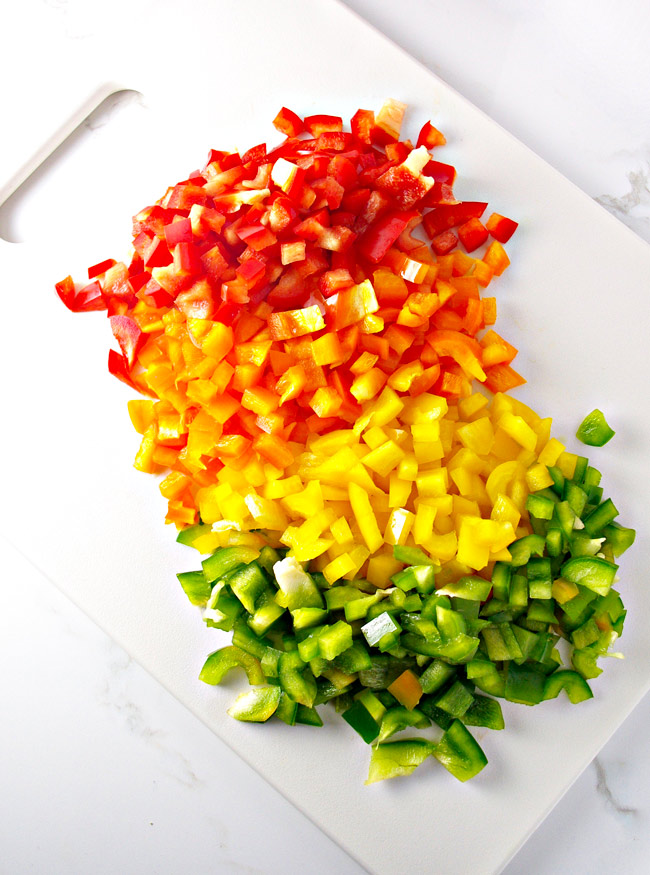 A rainbow of chopped bell peppers shows just how fun Hot 'n Spicy Pico de Gallo is to eat! | spiritedandthensome.com