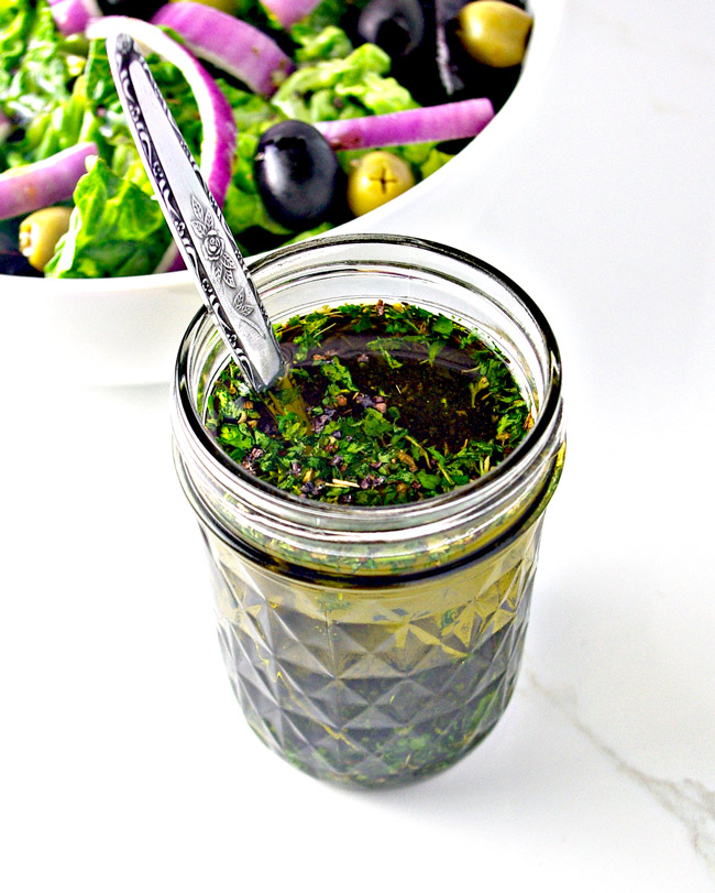 Homemade Italian Salad Dressing with onions, olives, and artisan lettuce! | spiritedandthensome.com