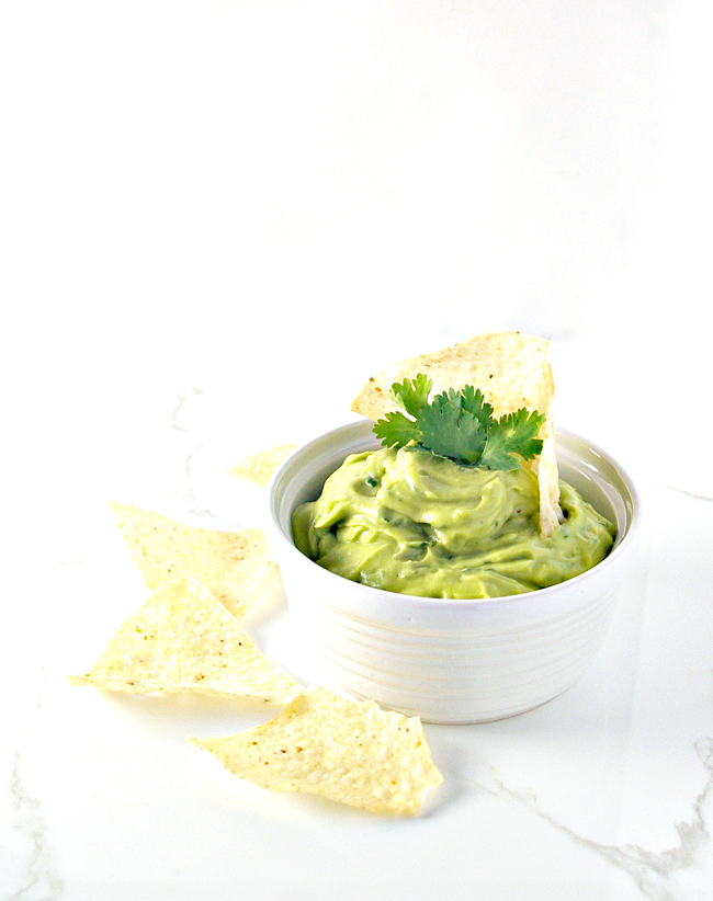 Lime juice and fresh cilantro take Creamy Avocado Lime Spread up a notch! | spiritedandthensome.com