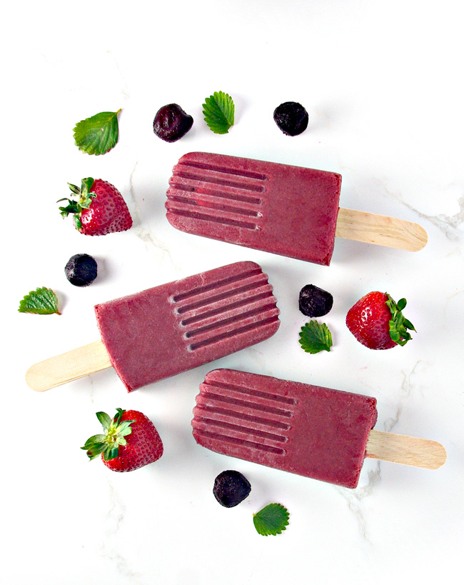 These healthy homemade Vegan Strawberry Cherry Popsicles contain just 4 ingredients! | spiritedandthensome.com