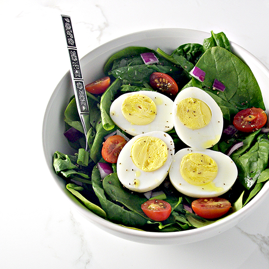 Say buh-bye to dimpled, dried, or undercooked hard-boiled eggs! This Perfect Hard-Boiled Egg recipe is super easy and a timesaver in the kitchen! | spiritedandthensome.com
