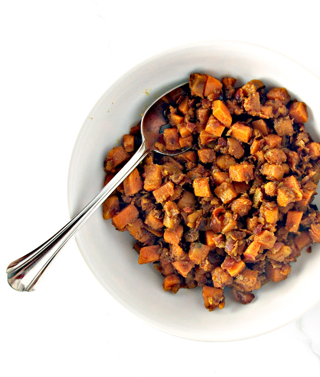 A delicious mixture of bacon, sweet potatoes, maple syrup, and spices for Maple Bacon Sweet Potatoes! | spiritedandthensome.com