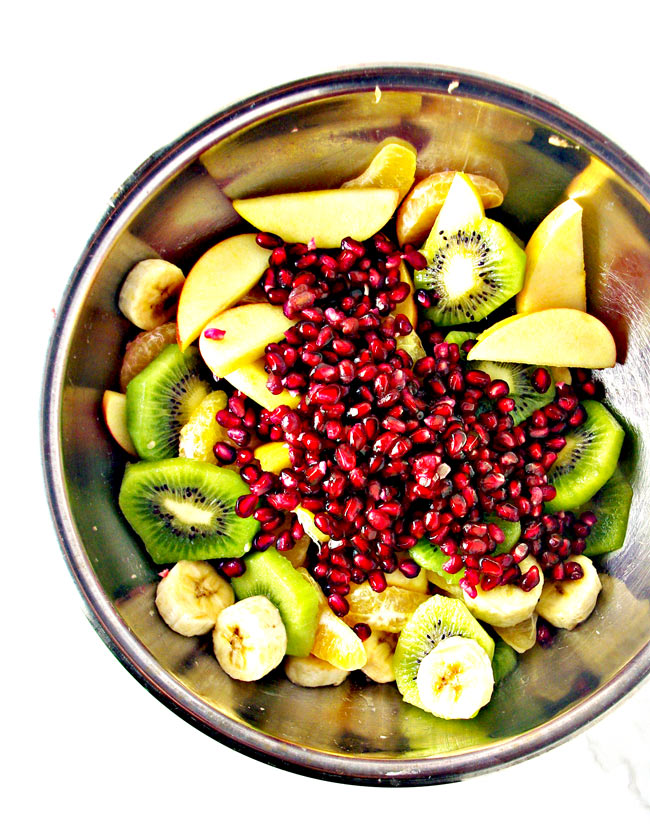 I throw all the fresh fruits together in one large mixing bowl for Paleo Winter Salad. Toss, serve, and ENJOY! | spiritedandthensome.com