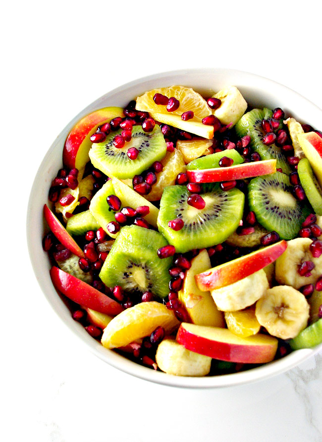 Paleo Winter Salad is full of kiwis, apples, bananas, pomegranate arils, and apples! | spiritedandthensome.com