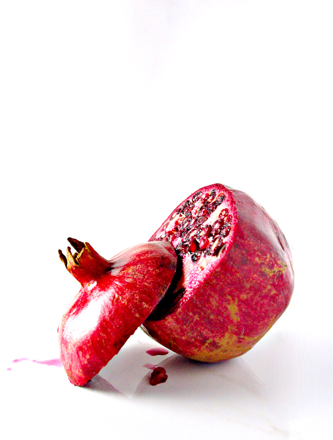 Slice the crown off a pomegranate to prepare 3-Ingredient Cranberry Pomegranate Spread! | spiritedandthensome.com