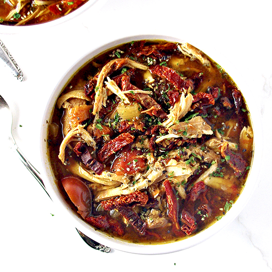 Hearty, delicious, and slow-cooker prepared, Sun-Dried Tomato Chicken Soup is paleo-friendly and gluten-free! | spiritedandthensome.com