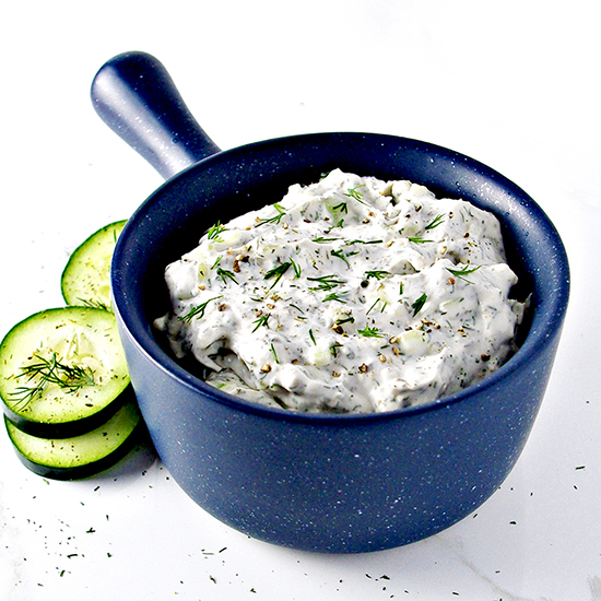 Paleo Tzatziki Sauce is deliciously vegan, paleo, gluten-free, soy-free, an dairy-free but totally big on FLAVOR! It's the perfect addition to main dishes. sandwiches, wraps, and appetizers! | spiritedandthensome.com