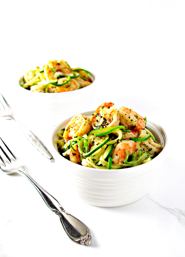 Two bowls of this Italian Shrimp Scampi Zoodle Bowl are perfect for a night in! Basil, oregano, parsley, and garlic take this flavor up a notch! | spiritedandthensome.com