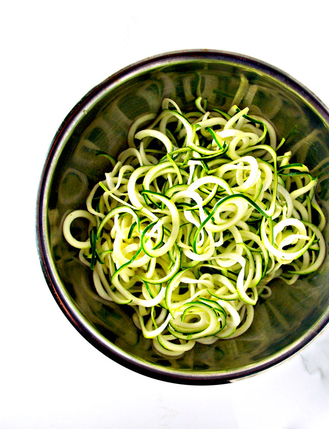 Zucchini noodles in a bowl for an Italian Shrimp Scampi Zoodle Bowl! | spiritedandthensome.com