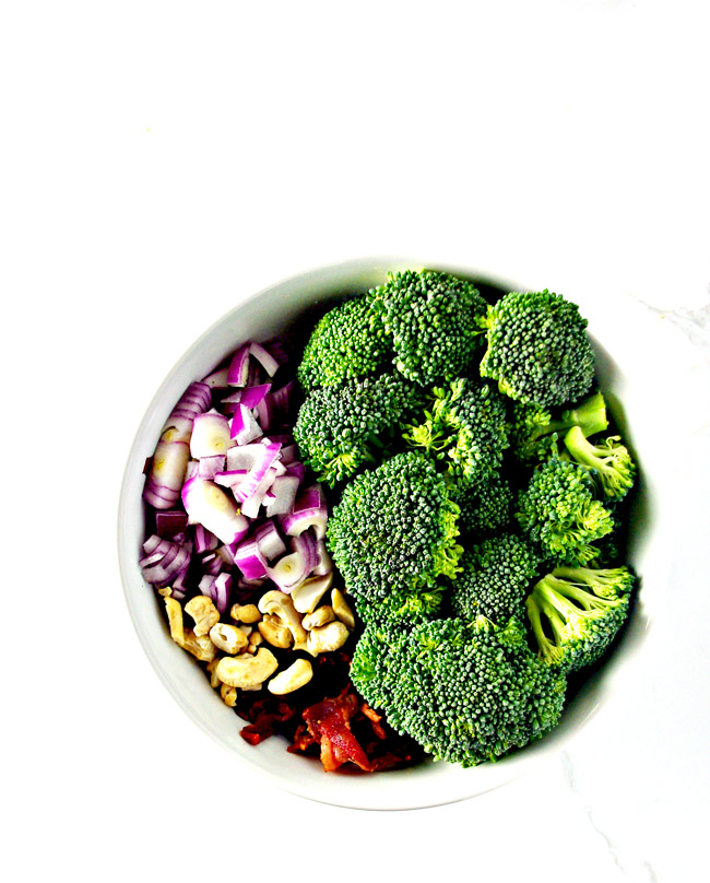 Easy Broccoli Bacon Salad ingredients in a white bowl just waiting to be devoured! | spiritedandthensome.com