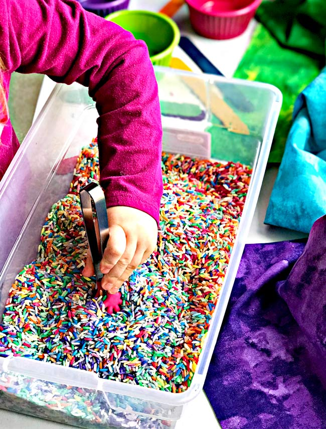 Sensory play ideas for preschoolers rainbow rice recipe! | spiritedandthensome.com