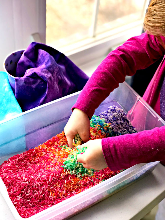 Sensory Play ideas for preschoolers sensory bins with rainbow rice! | spiritedandthensome.com