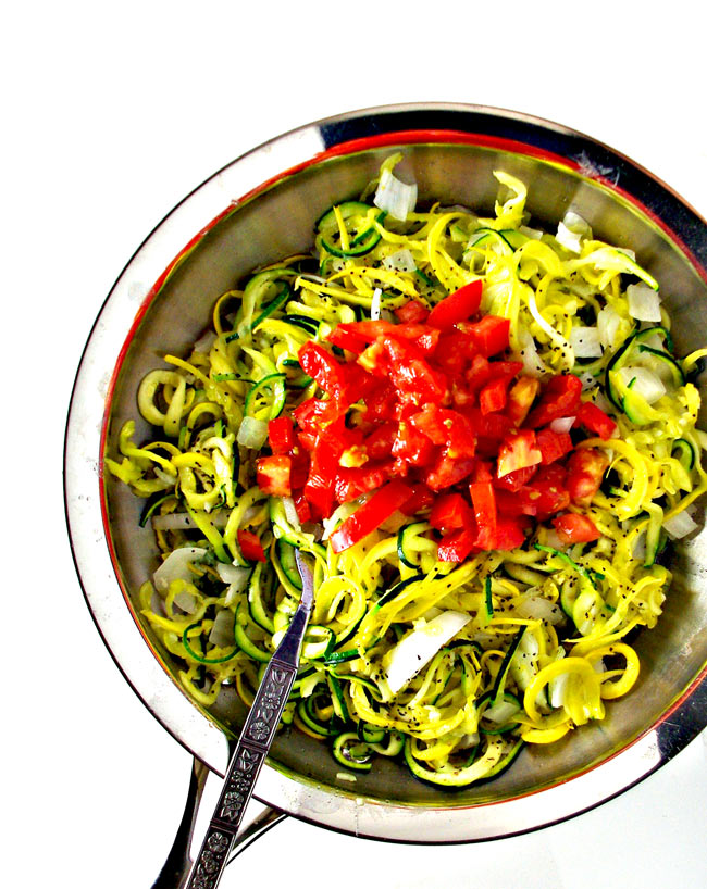 Easy Veggie Noodle Sauté in a skillet with tomatoes! | spiritedandthensome.com