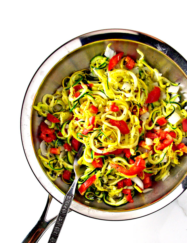 Easy Veggie Noodle Sauté mixed in a skillet with sea salt and pepper!   spiritedandthensome.com