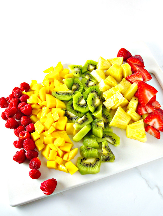 Mango Berry Salad ingredients on a cutting board just waiting to be made! | spiritedandthensome.com