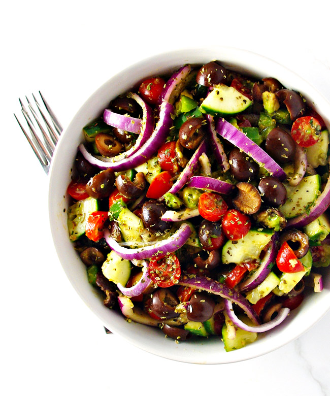 Paleo Greek Salad is full of robust flavor, a delicious homemade dressing, and lots of yummo crunch! | spiritedandthensome.com
