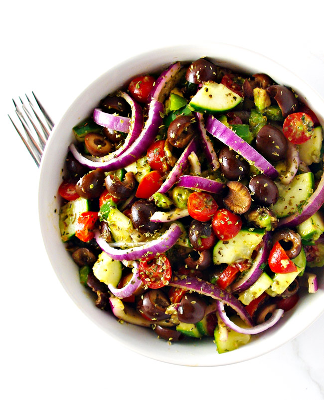 Paleo Greek Salad is full of delicious flavor with vegan-friendly variations, too! | spiritedandthensome.com