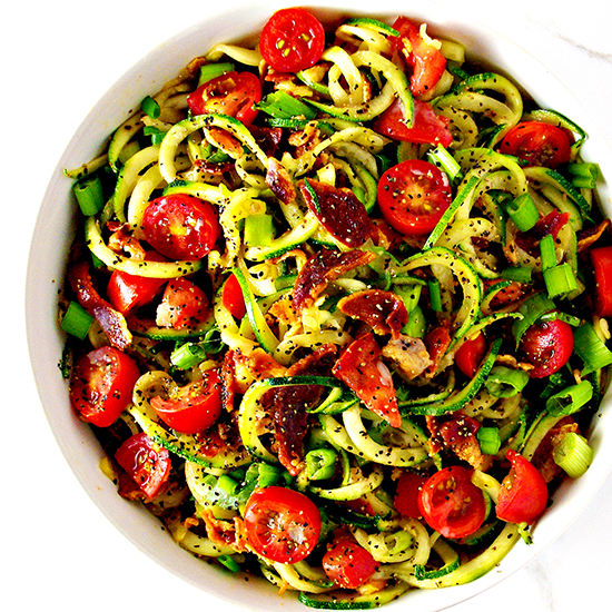 This Bacon Zoodle Salad is the perfect blend of savory, crunchy flavors and succulent, juicy fruits and vegetables! {Paleo-friendly} | spiritedandthensome.com