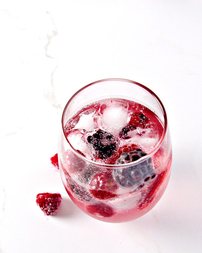 Vegan and gluten-free, this Mixed Berry Sparkling Water recipe is perfect for summer! | spiritedandthensome.com