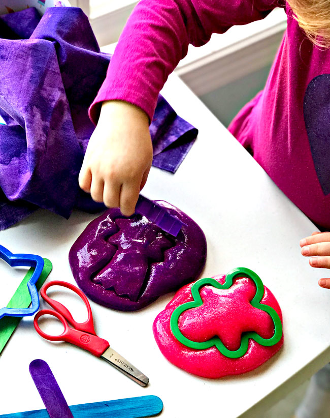 Sensory Play Ideas for Preschoolers include this Homemade Easy Slime recipe with cookie cutters! | spiritedandthensome.com