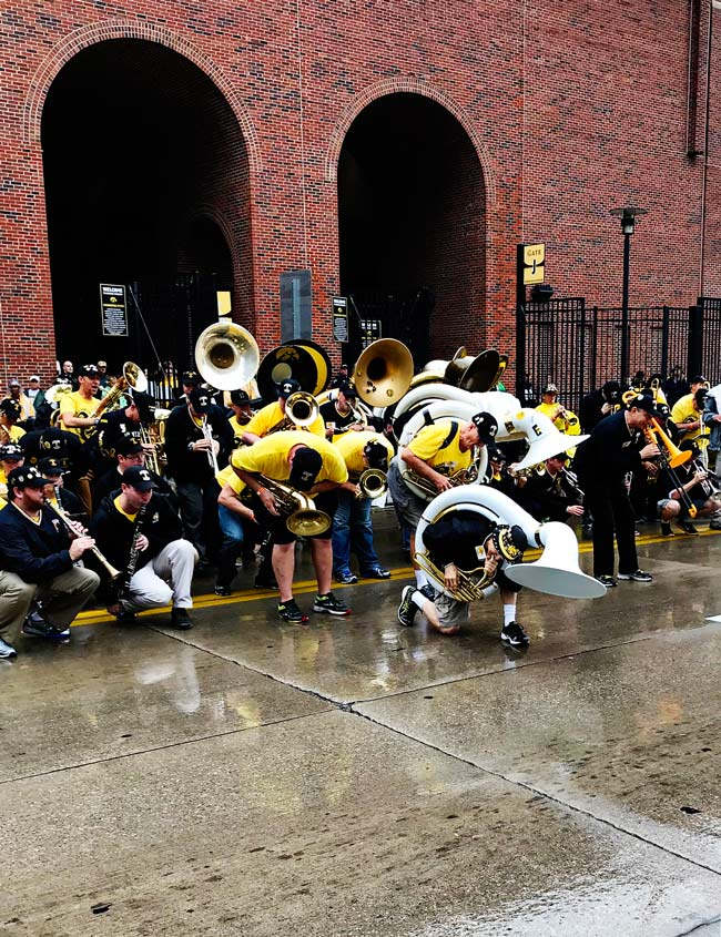 K-Hubs playing his sousaphone in from of the University of Iowa Stead Family Children's Hospital for University of Iowa homecoming! | spiritedandthensome.com