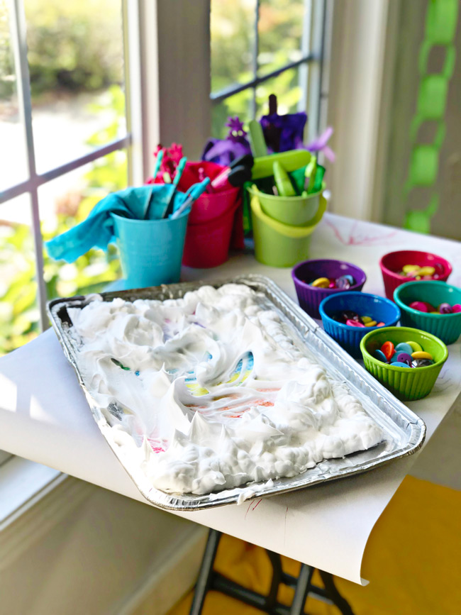 Shaving cream on laminated rainbows for Rainbow Sensory Trays! | spiritedandthensome.com