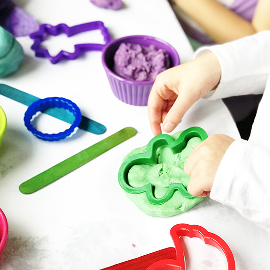 Toodle plays with cookie cutters and Gluten-Free Playdough! | spiritedandthensome.com
