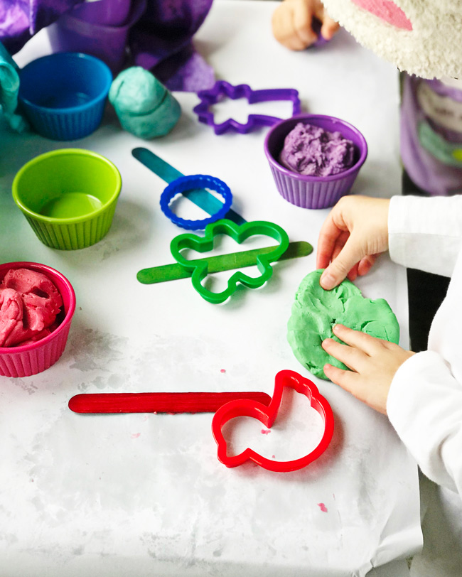Toodle working with a cookie cutter and a Gluten-Free Playdough recipe! | spiritedandthensome.com