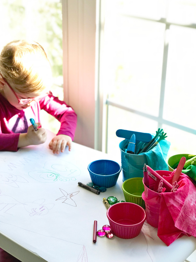 Twinkle setting up her work space for Rainbow Sensory Trays! | spiritedandthensome.com