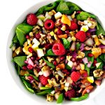 Pomegranate Pear Salad is full of fruits, savory onions, succulent leafy greens, crunchy walnuts, and a honey lime drizzle! Paleo, gluten-free, and dairy-free, too! | spiritedandthensome.com