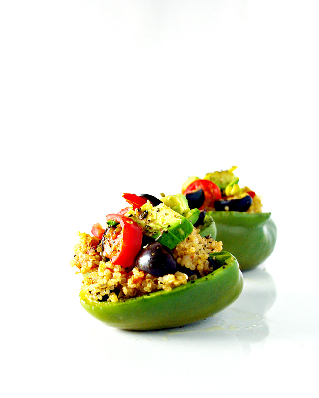Top your Spicy Quinoa-Stuffed Peppers with tomatoes, avocado, black olives, and whatever else you like! Vegan and gluten-free! | spiritedandthensome.com