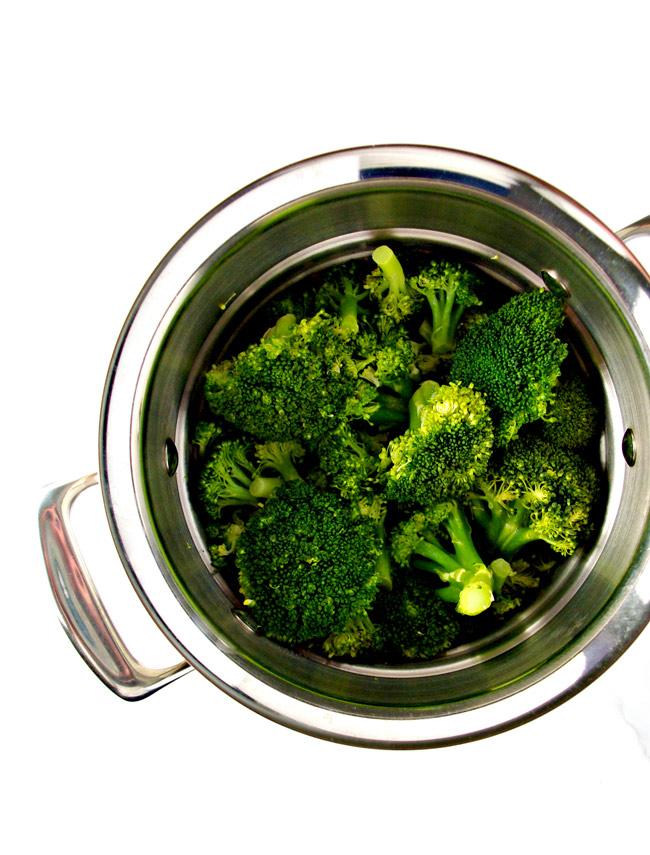 Broccoli in a stainless steel strainer for Dairy-Free Creamy Broccoli Soup! | spiritedandthensome.com